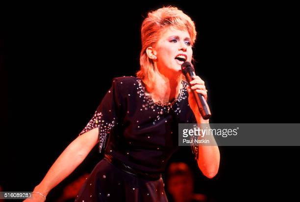 Britishborn Australian musician and actress Olivia NewtonJohn performs onstage Chicago Illinois August 29 1982