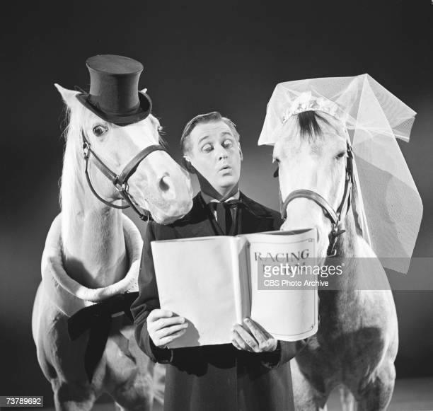Britishborn Canadian actor Alan Young born Angus Young reads from the racing form as the minister at a wedding between Bamboo Harvester and Rosita in...