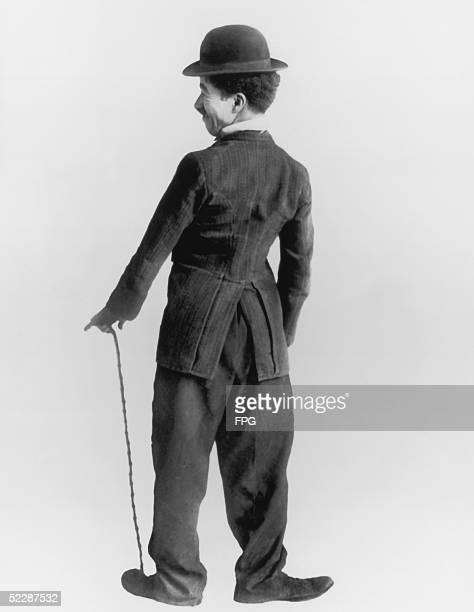 Britishborn comic actor Charles Chaplin in character as his movie alterego circa 1920