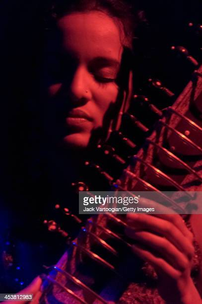 Britishborn Indian musician Anoushka Shankar plays sitar as she leads her ensemble during a performance at Joe's Pub New York New York October 27 2005