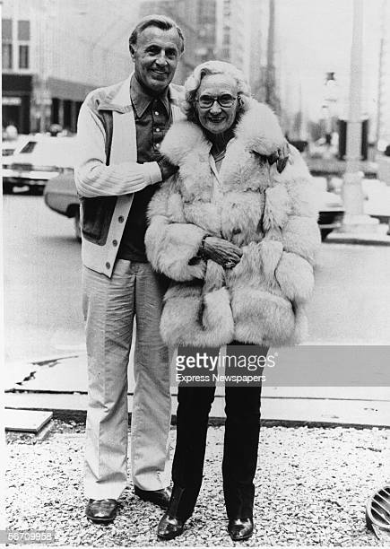 British-born parents of the pop and disco band The Bee Gees, Hugh and Barbara Gibb, display their finery as they pose for a photograph on a city...
