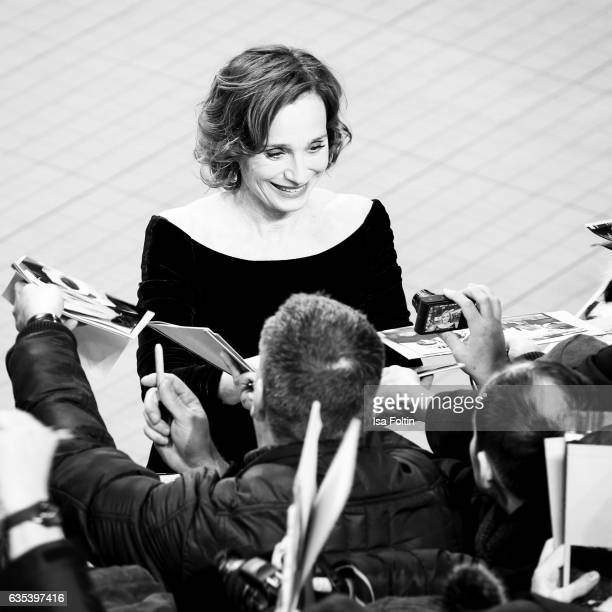 Britishfrench actress Kristin Scott Thomas signs autographs during the 'The Party' premiere during the 67th Berlinale International Film Festival...