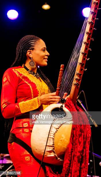 BritishGambian musician singer and griot Sona Jobarteh plays kora during a World Music Institute concert at Symphony Space New York New York June 23...
