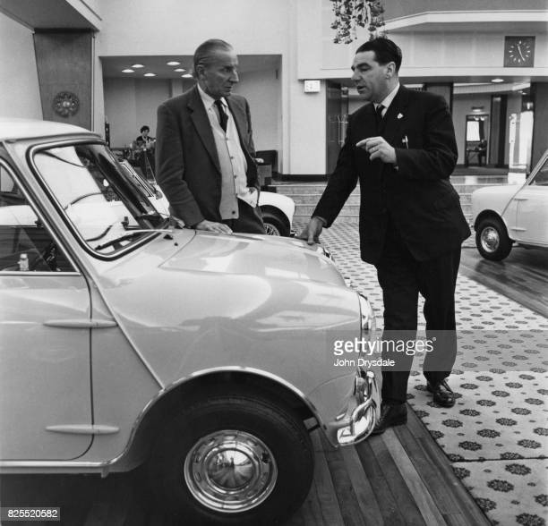 BritishGreek car designer Alec Issigonis Technical Director of BMC talking to John Cooper about the Mini Cooper at Longbridge Birmingham December 1962