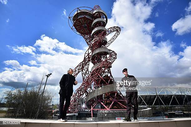 BritishIndian artist Anish Kapoor and Belgian artist Carsten Holler pose for a photograph as during an event to promote the 'The Slide' a new...
