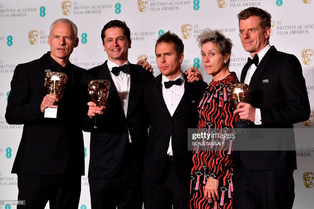 TOPSHOT - British-Irish filmmaker Martin McDonagh (L), producer Peter Czernin (2L), supporting actor award winner US actor Sam Rockwell, and British producer Graham Broadbent (R) pose with leading actress award winner US actress Frances McDormand (2R) after receiving the award for Best Film for 'Three Billboards Outside Ebbing Missouri' at the BAFTA British Academy Film Awards at the Royal Albert Hall in London on February 18, 2018. PHOTO / Ben STANSALL