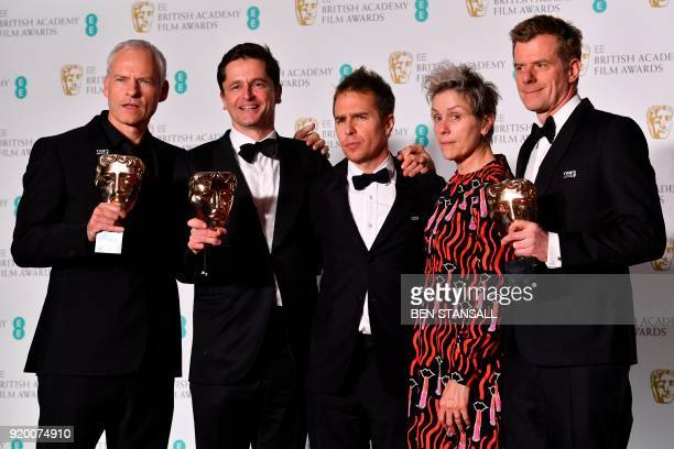 TOPSHOT BritishIrish filmmaker Martin McDonagh producer Peter Czernin supporting actor award winner US actor Sam Rockwell and British producer Graham...