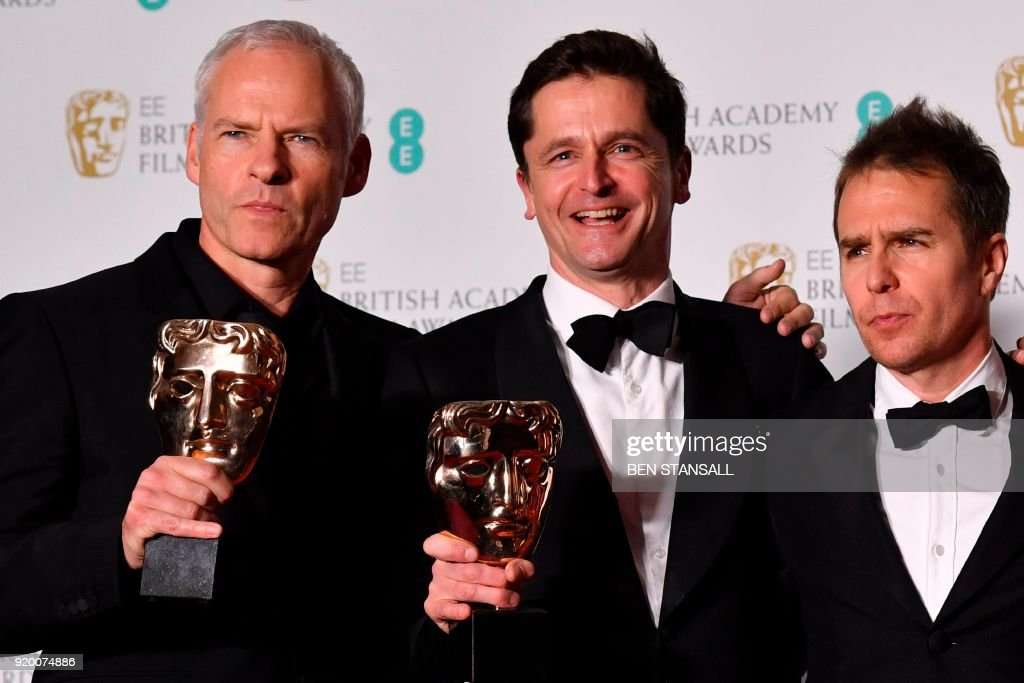 British-Irish filmmaker Martin McDonagh (L), producer Peter Czernin (C) hold their awards for Best Film with US actor Sam Rockwell for the film 'Three Billboards Outside Ebbing Missouri' at the BAFTA British Academy Film Awards at the Royal Albert Hall in London on February 18, 2018. PHOTO / Ben STANSALL