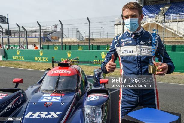 British's driver Paul Di Resta poses by his Oreca 07-Gibson LMP2 WEC racing car after he clocked the LMP2 Category best time during the 88th edition...