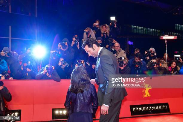 BritishSpanish actress Dafne Keen and Australian actor Hugh Jackman pose on the red carpet for the premiere of the film 'Logan' in competition at the...