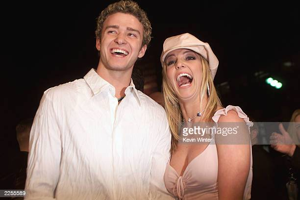 Britney Spears and boyfriend Justin Timberlake arrive at the premiere of her movie Crossroads at the Mann Chinese Theatre in Hollywood Ca Feb 11 2002