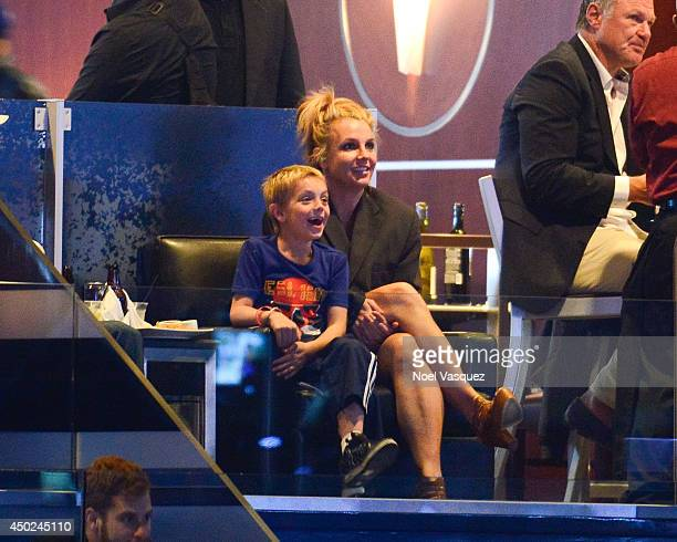 Britney Spears and her son Jayden James Federline attend a hockey game between the New York Rangers and the Los Angeles Kings in Game Two of the 2014...