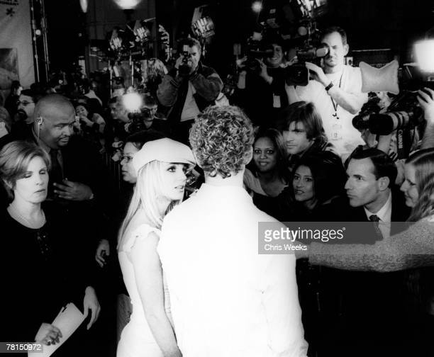 Britney Spears and Justin Timberlake are interviewed by the media while arriving at the premiere of Crossroads February 11 in Hollywood