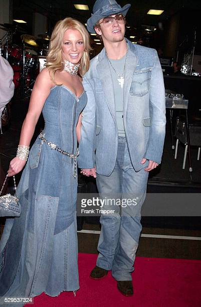 Britney Spears and Justin Timberlake backstage at the 28th annual American Music Awards held at the Shrine Auditorium