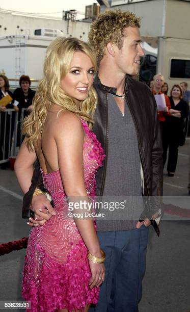 Britney Spears and Justin Timberlake pose for photographers at the 29th Annual American Music Awards at the Shrine Auditorium in Los Angeles