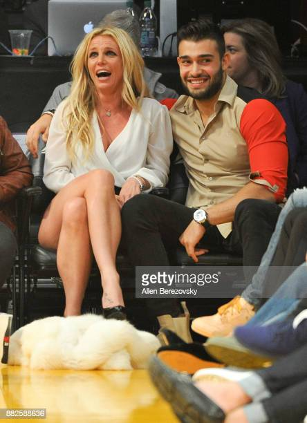 Britney Spears and Sam Asghari attend a basketball game between the Los Angeles Lakers and the Golden State Warriors at Staples Center on November 29...