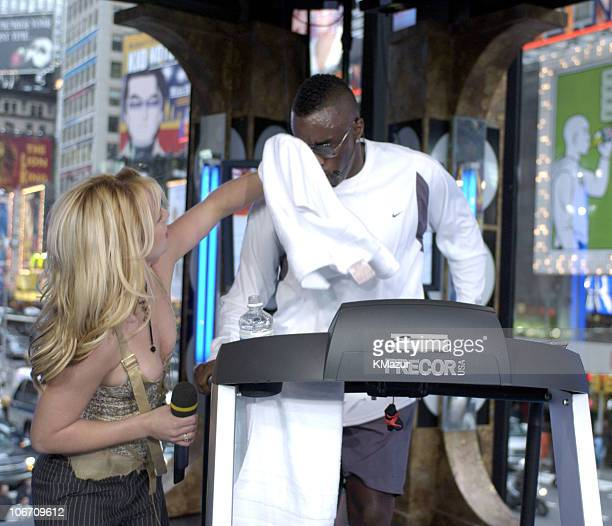 Britney Spears and Sean P Diddy Combs during Britney Spears Sean P Diddy Combs and Travis Fimmel Visit MTV's TRL TreadmillAThon October 22 2003 at...