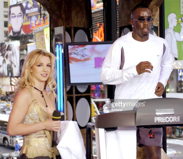 Britney Spears and Sean 'P Diddy' Combs during Britney Spears Sean 'P Diddy' Combs and Travis Fimmel Visit MTV's 'TRL' TreadmillAThon October 22 2003...