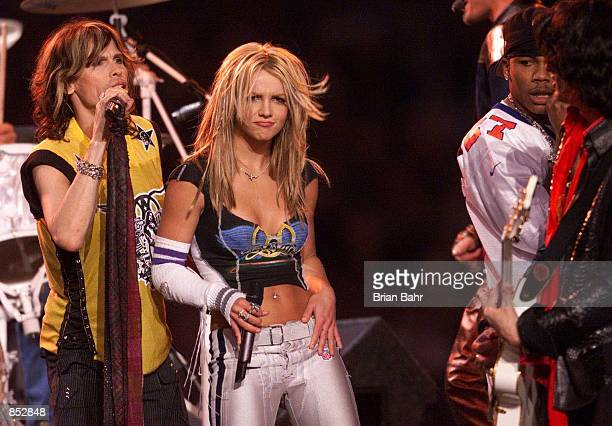 Britney Spears and Steven Tyler of Aerosmith perform together during the halftime show January 28 2001 at Super Bowl XXXV at Raymond James Stadium in...