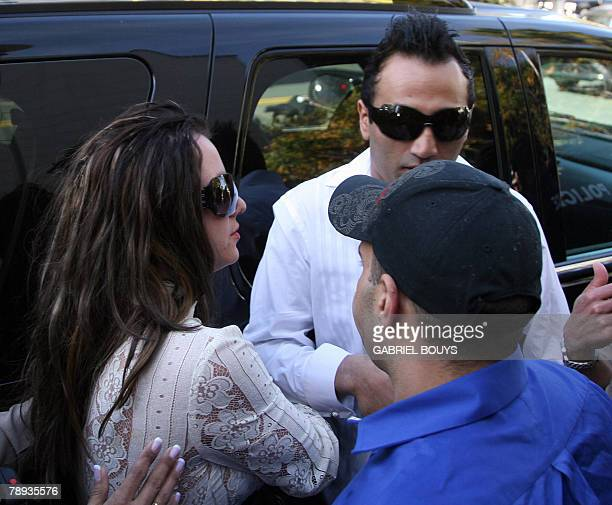 Britney Spears arrives with her boyfriend Adnan Ghalib at the Los Angeles County Superior courthouse 14 January 2008 for a hearing regarding...