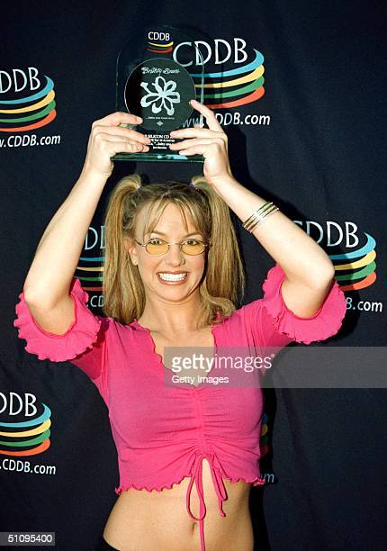 Britney Spears Goes Silicon On The Internet Britney Was All Hugs And Kisses When She Was Surprised With The Silicon Cd Award Presented By Cddb For...