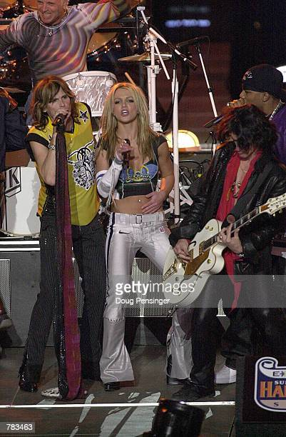 Britney Spears performs with Aerosmith during the halftime show for Super Bowl XXXV January 28 2001 at the Raymond James Stadium in Tampa FL