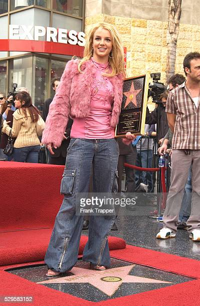 Britney Spears poses at her star on the Hollywood Walk of Fame
