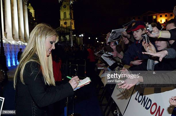 Britney Spears signs autographs during the Premiere for the new Pepsi Music Commercial Pepsi Gladiators at the National Gallery in Trafalgar Square...