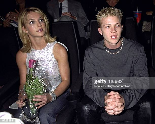 Britney Spears sits at a screening of 'Drive Me Crazy' at Union Square Theater with Robbie Carrico