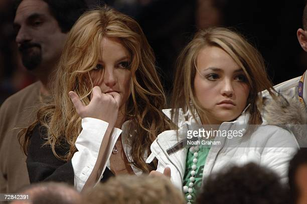 Britney Spears stands courtside with sister Jamie Lynn as the Los Angeles Lakers play against the Washington Wizards on December 17 2006 at Staples...