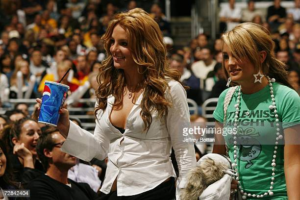Britney Spears walks through the crowd with sister Jamie Lynn Spears as the Los Angeles Lakers play against the Washington Wizards on December 17...