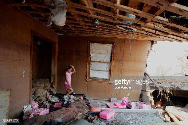 Britney Sylve walks in what used to be her bedroom looking for anything to salvage after it was destroyed by Hurricane Katrina September 12 2005 in...