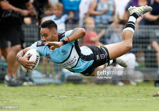 Briton Nikora of the Sharks scores a try during the round two NRL match between the Cronulla Sharks and the Gold Coast Titans at Shark Park on March...