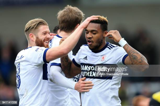 Britt Assombalonga of Boro celebrates with teammate Adam Clayton of Boro after scoring their 1st goal during the Sky Bet Championship match between...