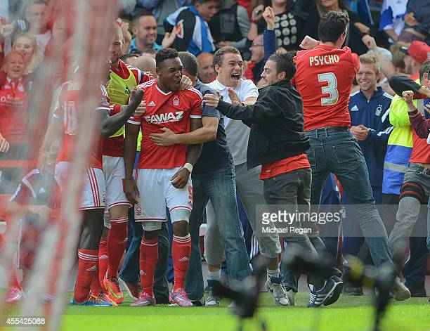 Britt Assombalonga of Forest celebrates scoring to make it 10 dwith team mates and fans during the Sky Bet Championship match between Nottingham...