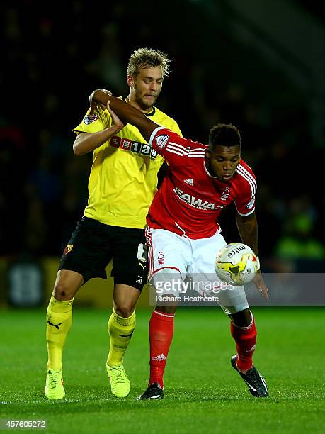 Britt Assombalonga of Forest holds off Joel Ekstrand of Watford during the Sky Bet Championship match between Watford and Nottingham Forest at...