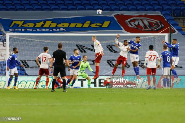 Britt Assombalonga of Middlesbrough and Curtis Nelson of Cardiff City jamp for the ball from a corner kick in the Cardiff box during the Sky Bet...