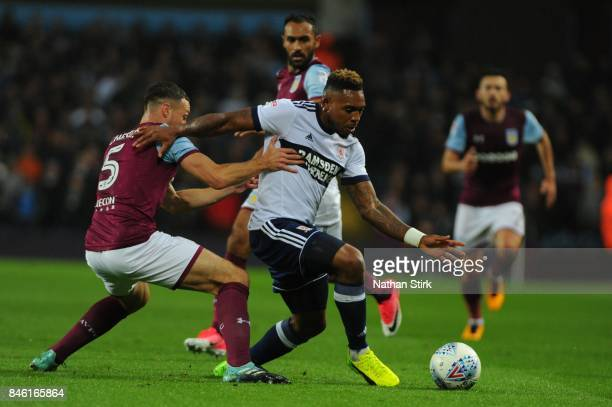 Britt Assombalonga of Middlesbrough and James Chester of Aston Villa in action during the Sky Bet Championship match between Aston Villa and...