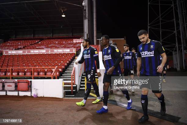 Britt Assombalonga of Middlesbrough, Marc Bola and Sam Morsy lead the team out ahead of the Sky Bet Championship match between Nottingham Forest and...