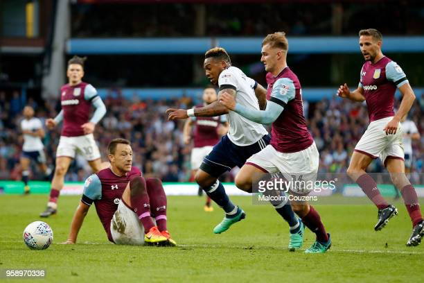 Britt Assombalonga of Middlesbrough runs past John Terry and James Bree of Aston Villa during the Sky Bet Championship Play Off Semi FinalSecond Leg...