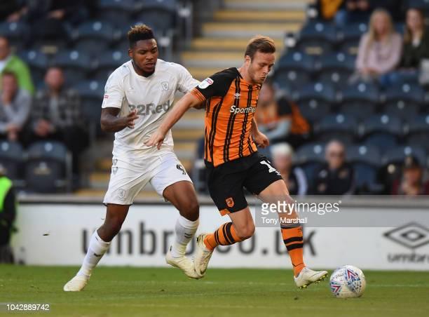 Britt Assombalonga of Middlesbrough tackles Todd Kane of Hull City during the Sky Bet Championship match between Hull City and Middlesbrough at KCOM...