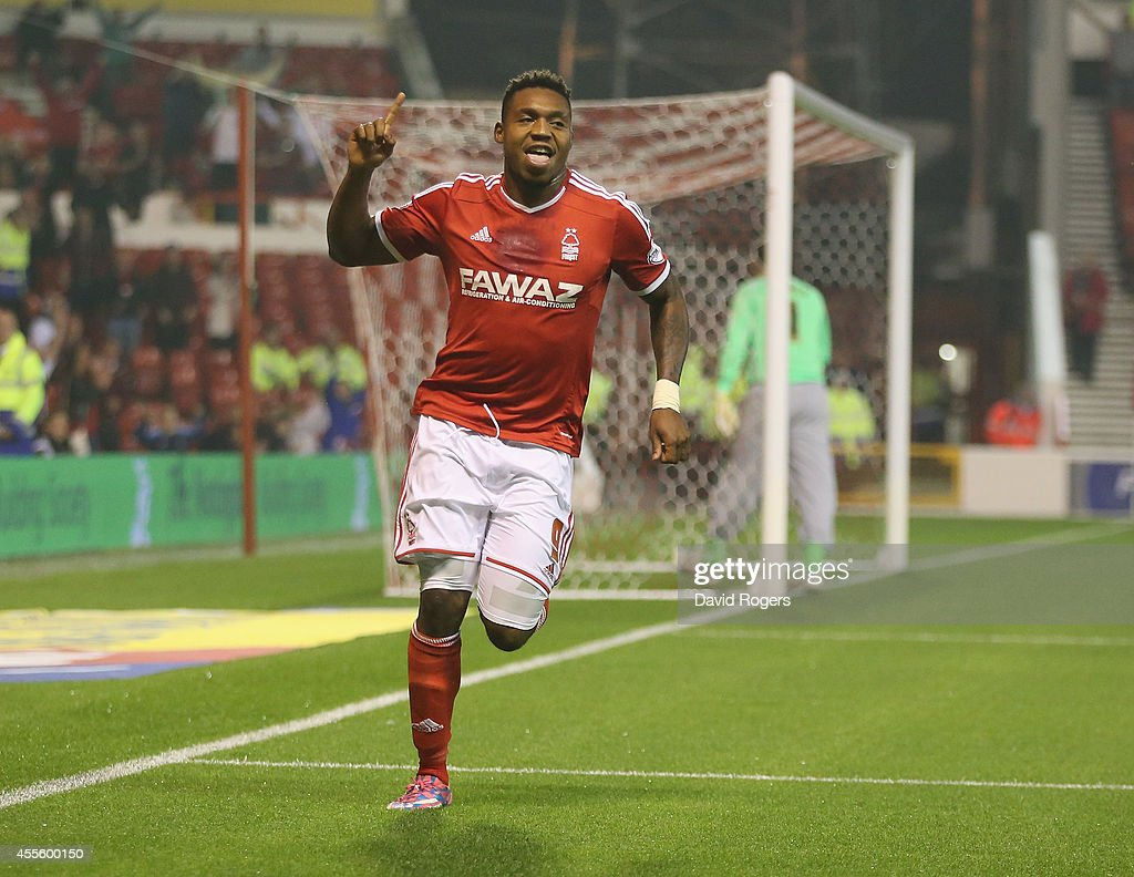 Britt Assombalonga of Nottingham Forest celebrates after scoring the first goal during the Sky Bet Championship match between Nottingham Forest and Fulham at the City Ground on September 17, 2014 in Nottingham, England.