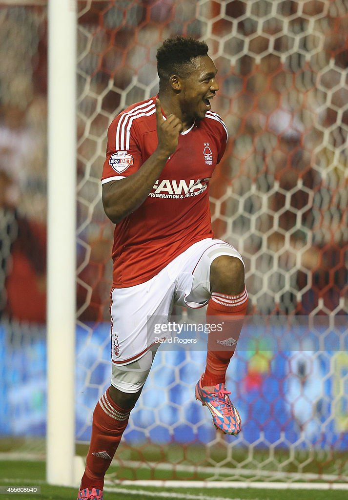 Britt Assombalonga of Nottingham Forest celebrates with after scoring their fourth goal and his hat trick during the Sky Bet Championship match between Nottingham Forest and Fulham at the City Ground on September 17, 2014 in Nottingham, England.