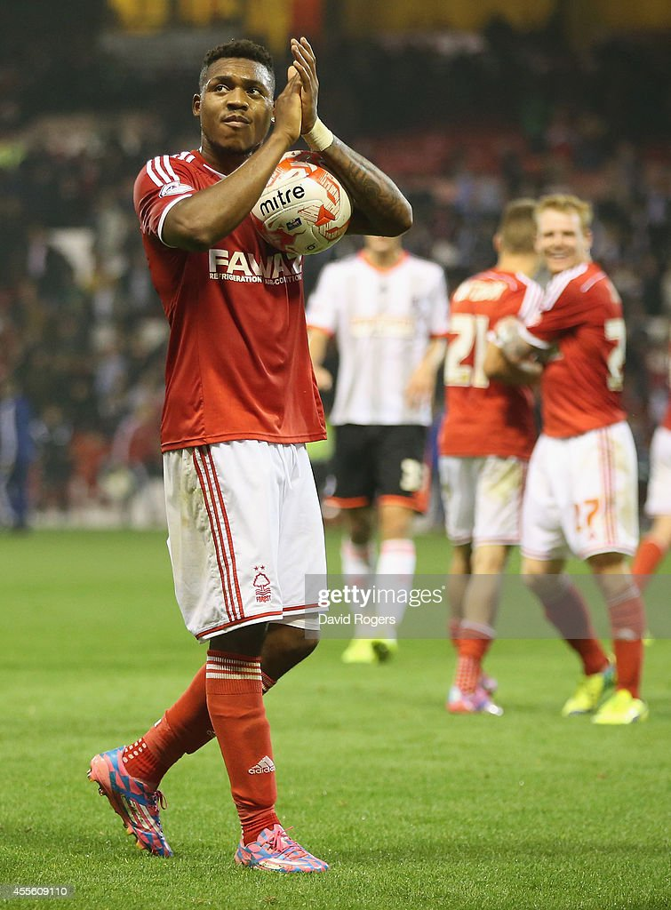 Britt Assombalonga of Nottingham Forest, who scored a hat trick, holds onto the match ball after the Sky Bet Championship match between Nottingham Forest and Fulham at the City Ground on September 17, 2014 in Nottingham, England.