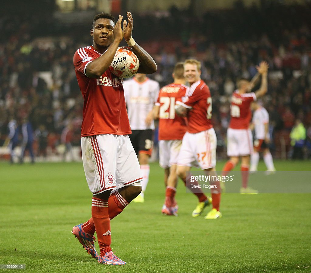 Britt Assombalonga of Nottingham Forest, who scored a hatt rick, holds onto the match ball after the Sky Bet Championship match between Nottingham Forest and Fulham at the City Ground on September 17, 2014 in Nottingham, England.