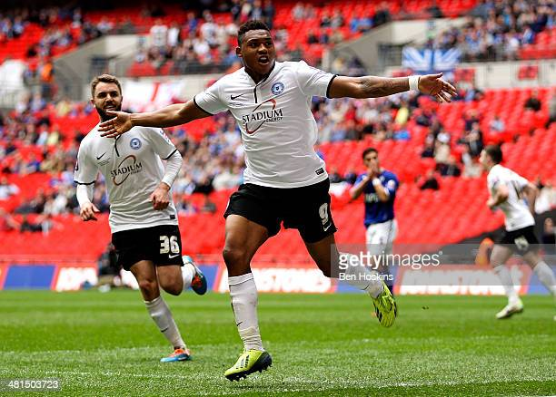 Britt Assombalonga of Peterborough celebrates after scoring his team's third goal of the game during the Johnstone's Paint Trophy Final between...