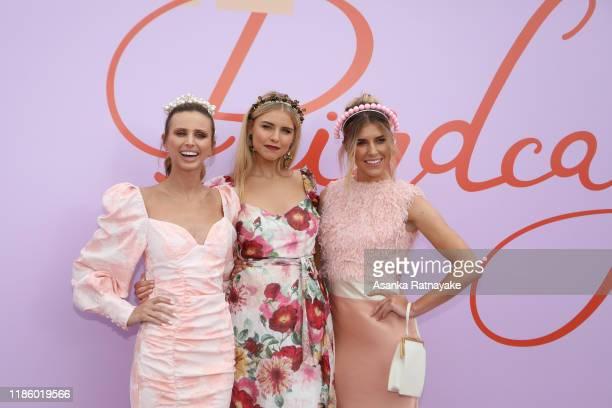 Britt Davis, Tegan Martin and Georgia Connolly attend Oaks Day at Flemington Racecourse on November 07, 2019 in Melbourne, Australia.