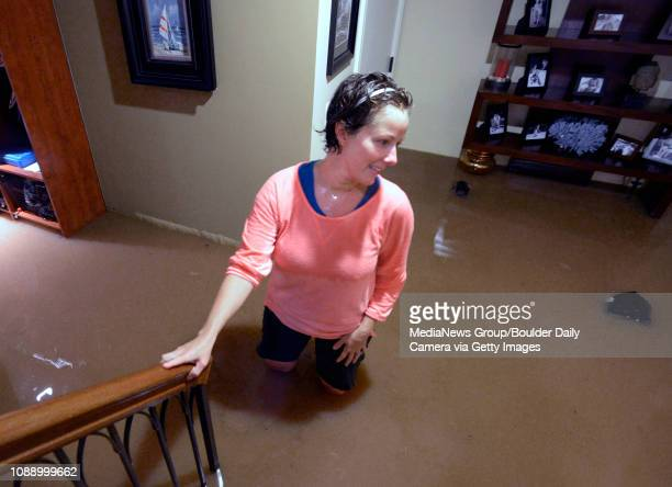 Britt Drake of Boulder stands in her flooded basement during the heavy flooding on Thursday in Boulder For a video of the flooding go to...