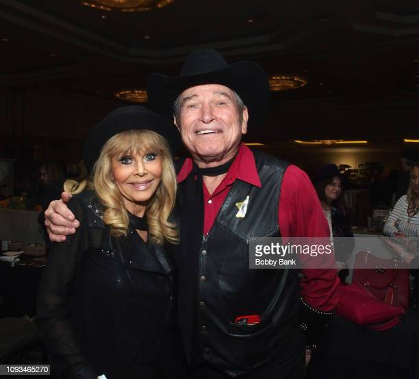 Britt Ekland and Burton Gilliam attend The Hollywood Autograph Show at The Westin Los Angeles Airport on February 3 2019 in Los Angeles California