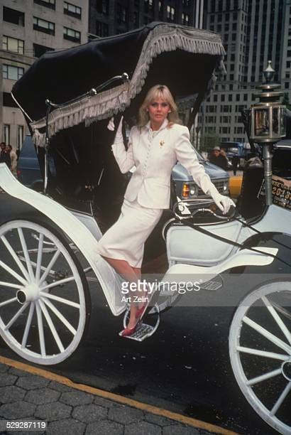 Britt Ekland in a white suit getting out of a Central Park carriage circa 1970 New York